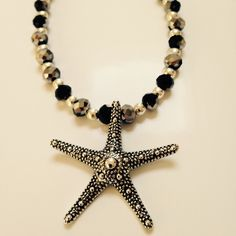 Handmade Necklace HP Reduced✂️ Silver starfish pendent with silver and iridescent accent beads. 16 inches. Handmade Jewelry Necklaces
