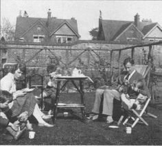 Tolkien, wife Edith, and kids -- evidently having tea!  I believe this may be the house on Northmoor in Oxford.