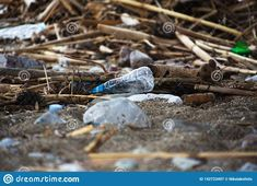 Photo about Spilled garbage on the beach.Empty used plastic bottle.Planet lution.Dirty beach. Image of ecological, decoration, environmental - 142723497