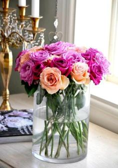 flower decor. purple/fuscia + peach/orange flowers love the color combo rm