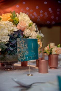 Teal, peach, ivory and copper wedding centrepiece. Surrey wedding flowers by Boutique Blooms floral design. Teal Wedding Centerpieces, Teal Wedding Flowers, Teal And Grey Wedding, Teal Blue Weddings, Best Wedding Colors, Teal And Gold, Wedding Table Decorations, Teal Flowers, Stage Decorations