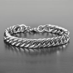 Create a modern minimalist look with this stainless steel curb link chain bracelet. This bracelet measures 8 inches, encloses with a lobster clasp and is perfect for casual wear. Silver Bracelets, Bracelets For Men, Fashion Bracelets, Silver Rings, Titanium Jewelry, Black Leather Bracelet, Palm Beach Jewelry, Gold Fashion, 90s Fashion