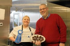 Lisa Roark, pastry chef at Kendal at Longwood, left, and Steve Wandishin, director of dining services at Kendal at Longwood, display Roark's prize-winning truffles. Roark took first place in the Professional Candy category at the United Way of Southern Chester County Kennett Chocolate Lovers Festival.