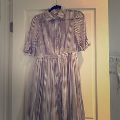 BEAUTIFUL FLOWY MAXI DRESS Honestly the prettiest dress !!! 60% cotton 40% silk. Buttons up all the way. Has two strings that once held a small blue belt but those can be cut off because the belt is gone. Has pockets. Navy blue and white Anthropologie Dresses Maxi