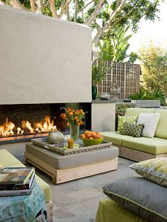 Large outdoor fireplace that keeps an entire sitting area warm, even after the sun sets.