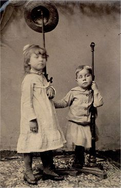 Children in photo are both deceased and held in place by poles. ___________________________________________________________________________                NOTE FROM IRENE LUNDRIGAN:  now that i take a closer look at the photo, i agree that they were most likely alive. FYI, I just re-posted the photo and the caption below it is not mine but was part of the description of the original posting.