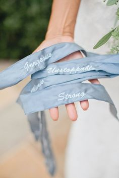 Hand stitched on the bridal bouquet words of encouragement and love.