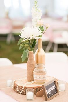 Wedding Table Decorations Using Wine Bottles Peach - 58 simple but beautiful wedding centerpiece ideas using wine bottles Wedding Centerpieces Mason Jars, Wedding Wine Bottles, Flower Centerpieces, Centerpiece Ideas, Beer Bottle Centerpieces, Vintage Centerpieces, Wood Slice Centerpiece, Quinceanera Centerpieces, Cheap Table Decorations