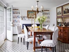 A white breakfast room featuring custom cement tile floors and wood accents   archdigest.com