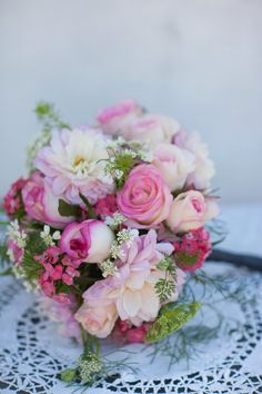Pretty pink roses in a lovely bridesmaid bouquet. Photography by Jess Roy