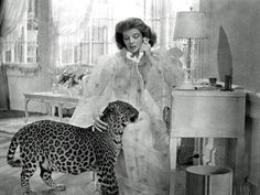 Katherine Hepburn and a leopard from Bringing Up Baby. Madcap heiress= crazy classy cat lady