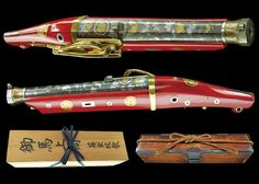 peashooter85:  An beautiful Japanese matchlock pistol with gold and silver inlays and red lacquered stock. Features the crest of the Tokugawa Clan.