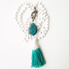 ANG SUNG WAHE GURU MALA  248.00 The Ang Sung Wahe Guru Mala is stunning in design and feel.  Made with white faceted jade, faceted pyrite, and ocean jasper. Strung on silk and finished with a dip dyed cotton tassel.  Infused with the mantra Ang Sung Wahe Guru which means the dynamic living ecstasy of the Universe is dancing within every cell of me. This mantra celebrates our union with the divine, removes haunting thoughts and relieves depression.