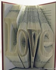Folded Book into...love. That's amazing...