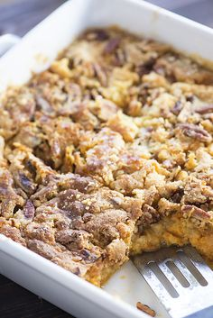 This pumpkin crunch cake has a cake topping with a bottom made of pumpkin pie…