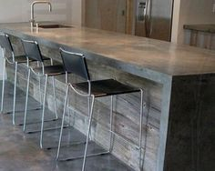 Concrete countertops/reclaimed wood bar....too modern for me but like ...
