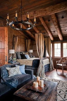 The rustic room is offset by the feminine textiles. Dancing Hearts, Montana - Style Estate -