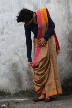 Raw silk saree or sari with blouse. Love the play of colours.