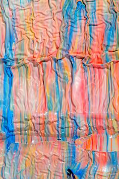 mark lovejoy's surreal spilled paint photos look like stretched taffy