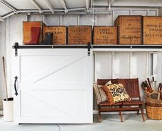 Is your garage a total mess? Here are 29 tips to declutter your garage this fall. For more garage organization ideas and storage tips, go to Domino. Barn Door Garage, Carriage House Garage, Barn Doors, Hanging Garage Shelves, Garage Wall Shelving, Garage Storage Solutions, Garage Organization, Storage Ideas, Storage Racks