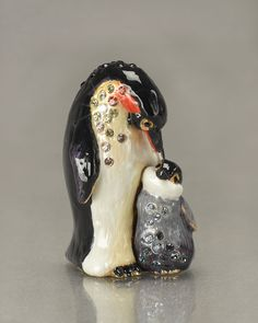 http://archinetix.com/jay-strongwater-marlow-and-olive-penguins-mini-figurine-p-2289.html