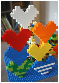 Build a LEGO heart for a simple engineering project for kids. LEGO hearts are a simple and fun STEM activity. Explore math and engineering with LEGO hearts! Lego Duplo, Lego Toys, Lego Ninjago, Stem Projects, Projects For Kids, Crafts For Kids, Simple Projects, Lego Design, Stem Activities