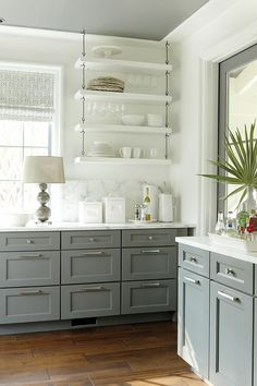 Grey kitchen cabinets in a traditional kitchen