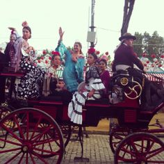 Fabulous flamencas in their carriage at the Seville Feria.