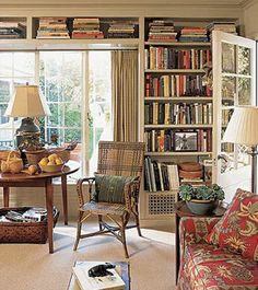 29 Cool Built-In Bookshelves Ideas For Your Home : 29 Cool Built In Bookshelves Ideas With White Wooden Bookshelves And Red Sofa Table And Rattan Chair And Desk Lamp And Brown Rug Small Home Libraries, Bookshelves Built In, Bookcases, Book Shelves, Baseboard Heating, Home Library Design, Library Ideas, D House, Living Spaces