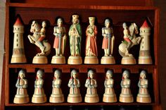 "Anri Charlemagne Chess Set. King height 3-1/2"". Hand-painted composition chessmen on wooden bases in fitted wooden presentation case. Produced around 1968."