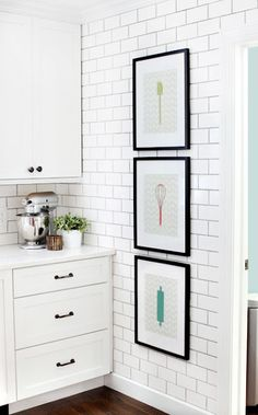 I am in love with these wall prints and the floor to ceiling subway tile!