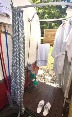 Outdoor shower off the side of the travel trailer