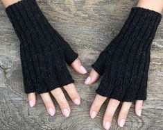 Knit wool gloves with half fingers are perfect for winter. These fingerless gloves are very warm and useful when you want to answer a phone or get your keys. They have half cut fingers and are made with alpaca. Cotton Gloves, Wool Gloves, Fingerless Gloves Knitted, Black Gloves, Alpaca Wool, Black Knit, Arm Warmers, Winter Gloves, Fingers