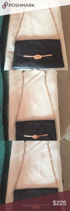 """COACH Bag. Authentic.  Brand new Genuine COACH bag. Black leather with brass hardware and chain. Elegant design. Fuchsia satin lining. 12"""" x 7"""" x 1"""".  Chain can be secured under flap for a shorter strap. Never used. Been sitting in my closet. Time for a good home. Coach Bags Crossbody Bags"""