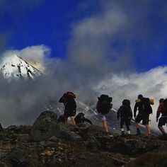 Guiding a group of enthusiastic school students in the Tongariro National Park, New Zealand