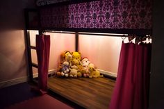 Christmas lights under Ikea Kura bed and maybe use our leftover laminate flooring