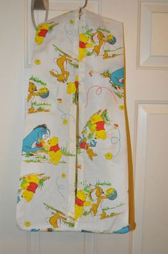 "Vintage Winnie The Pooh hanging ""diaper stacker""."