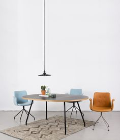 PRIMUM | A collection of dining chairs and tables.
