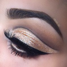"""A golden cut crease by @luminous_dee. Eyebrows: NYX Eyebrow Gel in """"Chocolate"""" and Eyebrow Cake Powder in """"Dark Brown"""". Eyes: Loose Pearl Pigment in """"Nude"""" and Two Timer Liner for eyeliner."""