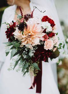 "The deep red flowers contrasted by the white flowers in this bouquet just scream ""winter wedding!"""