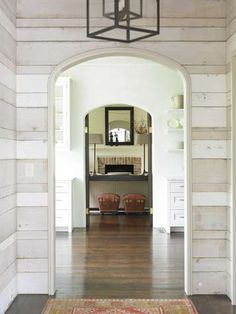 #arch + white wash + wall paneling