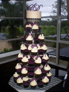 I like this idea! A small cake to cut and cupcakes for the reception.