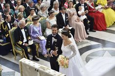 Sofia Hellqvist and Sweden's Prince Carl Philip stand at the alter during their wedding ce...