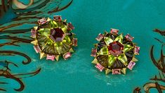 """Petal Dance"" earrings made of tourmaline, peridot, and 18K gold."