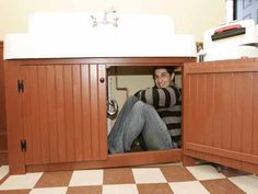 Ian Petrella (Randy) once again hiding under the sink in A Christmas Story House