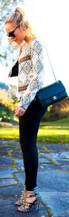 Pop print blazer . black legging and studded heels...