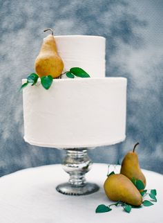 Pure, natural beauty. The perfection of Bosc pears against a simple white cake cannot be improved upon to any degree.