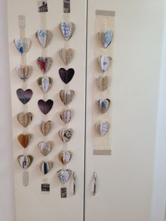 Love heart bunting! Sewn together from old books, drawings and lace.