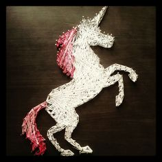 A string art unicorn I made, artist @em_bergie #craft #unicorn #stringart
