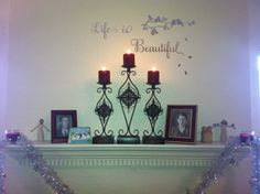My new mantle decorations. Found the mirror appliqué at Pier 1. Life Is Beautiful is my favorite movie so I had to have it. Candle holders also from Pier 1.